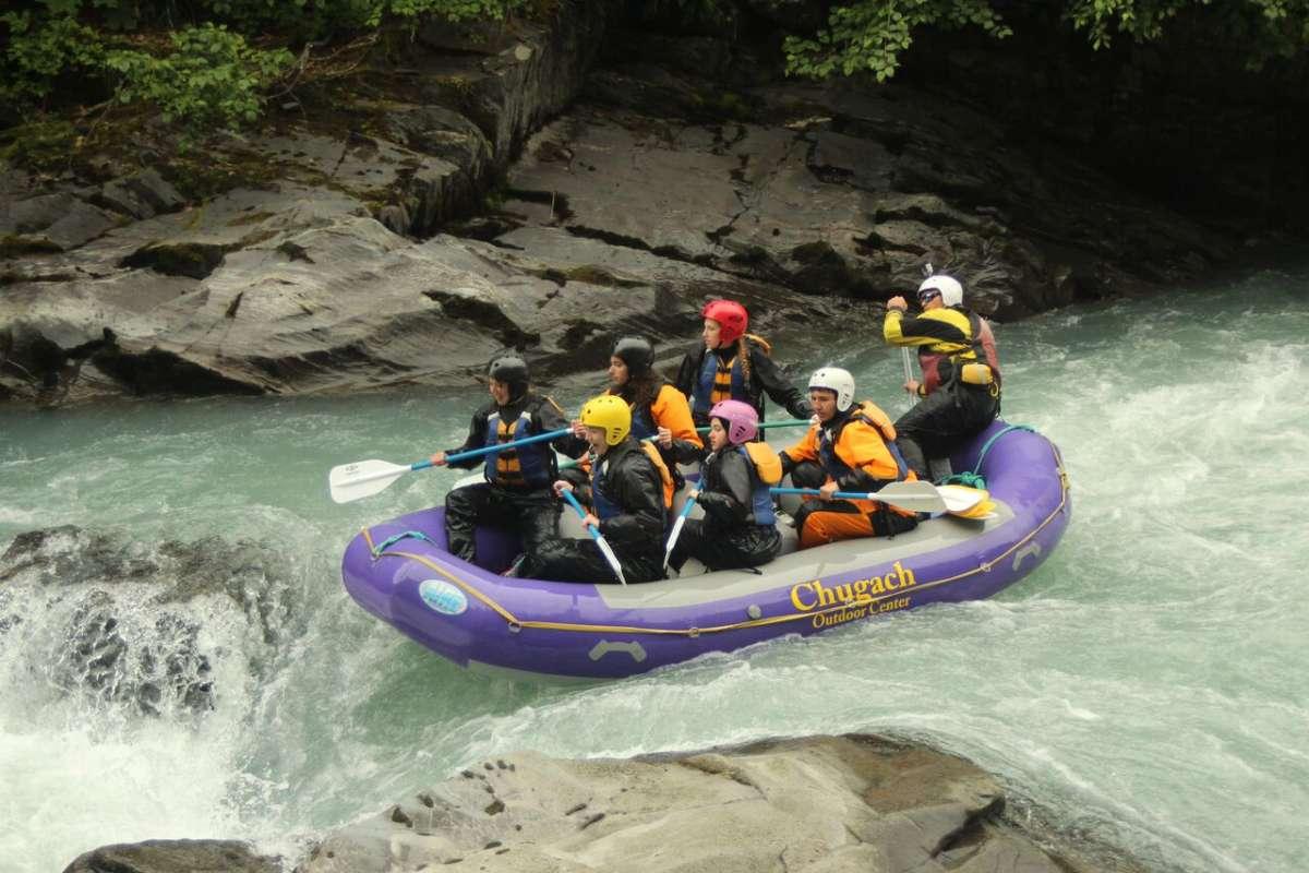 Group of teens whitewater rafting on Alaska summer travel program