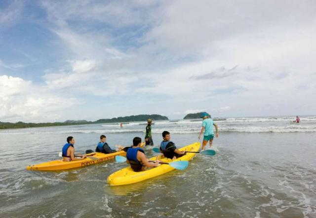 Group of teens go kayaking on summer adventure program in Costa Rica.