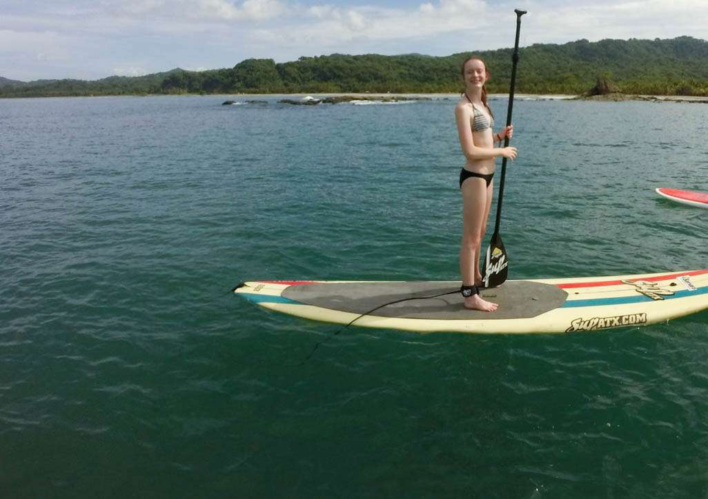 Teen learns how to stand-up on adventure program in Costa Rica.