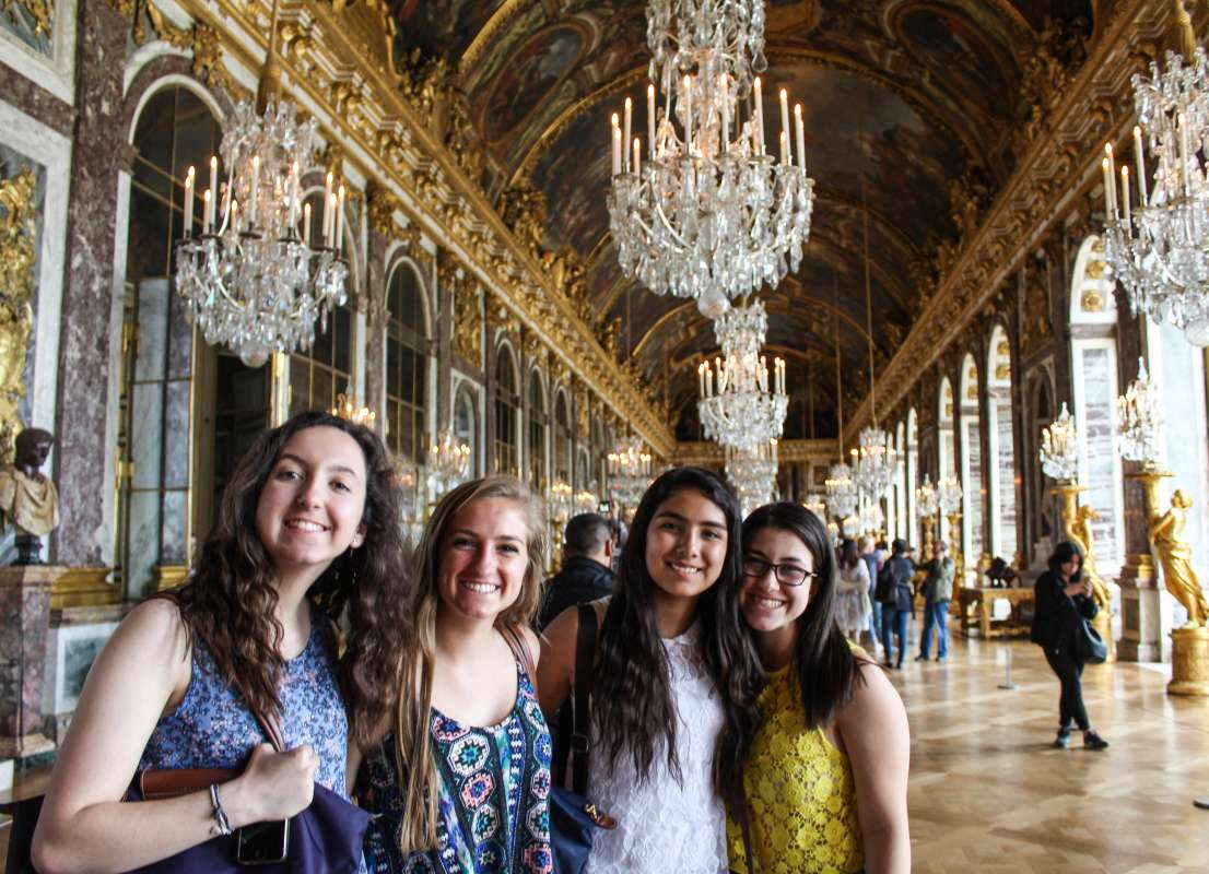 Younger teen travelers at Hall of Mirrors in Versailles on student travel program