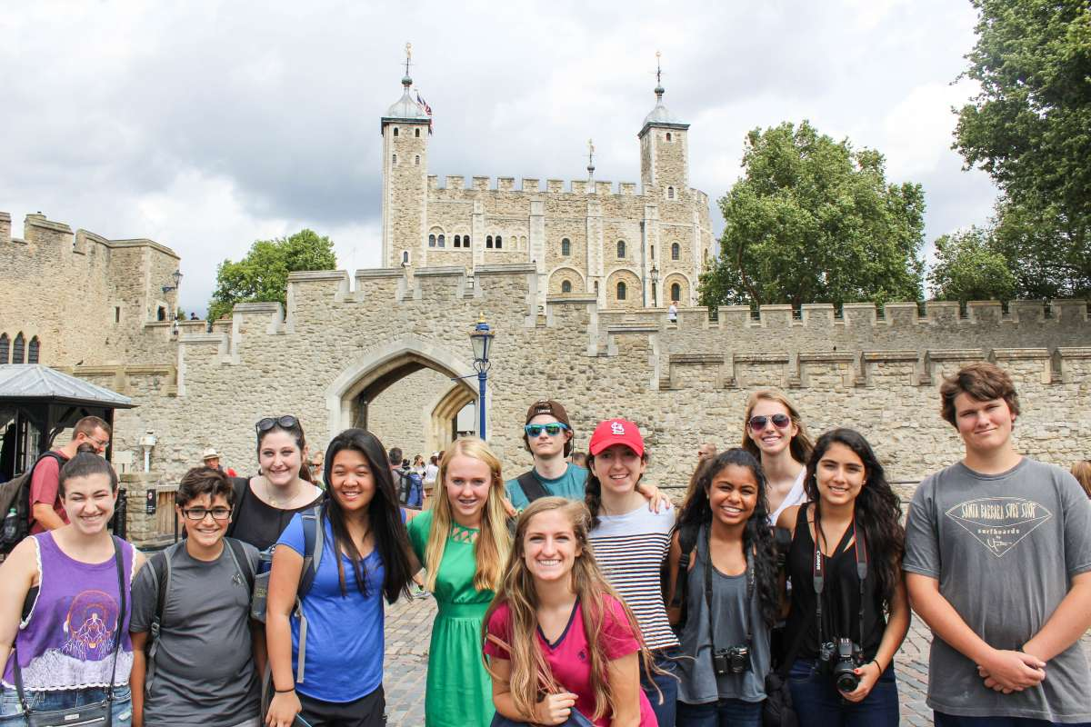 Group of teen travelers at Tower of London during summer youth travel program