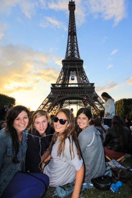 Teens at Eiffel Tower during summer youth travel program