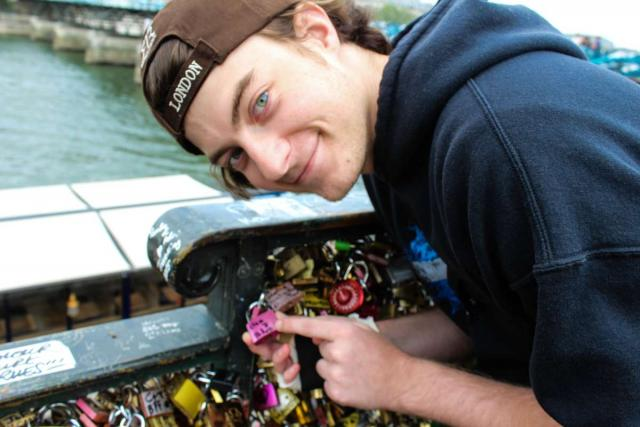 Teen traveler at River Seine in Paris during youth travel program