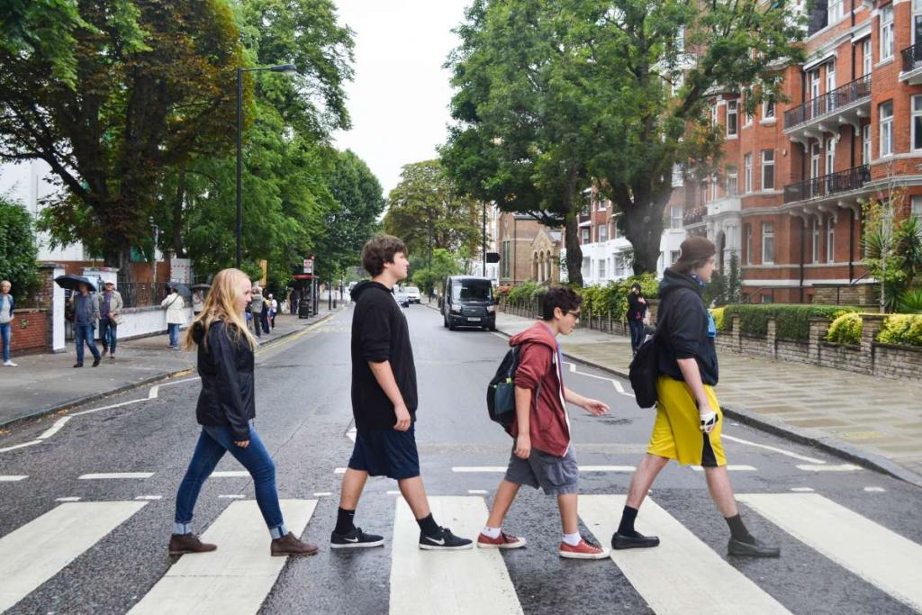 Middle school travelers cross Beatles Abbey Road in London on summer youth travel program