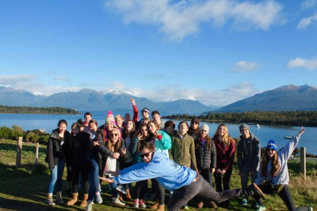 Group of happy teens posing for a photo on a summer travel tour in Australia and New Zealand.