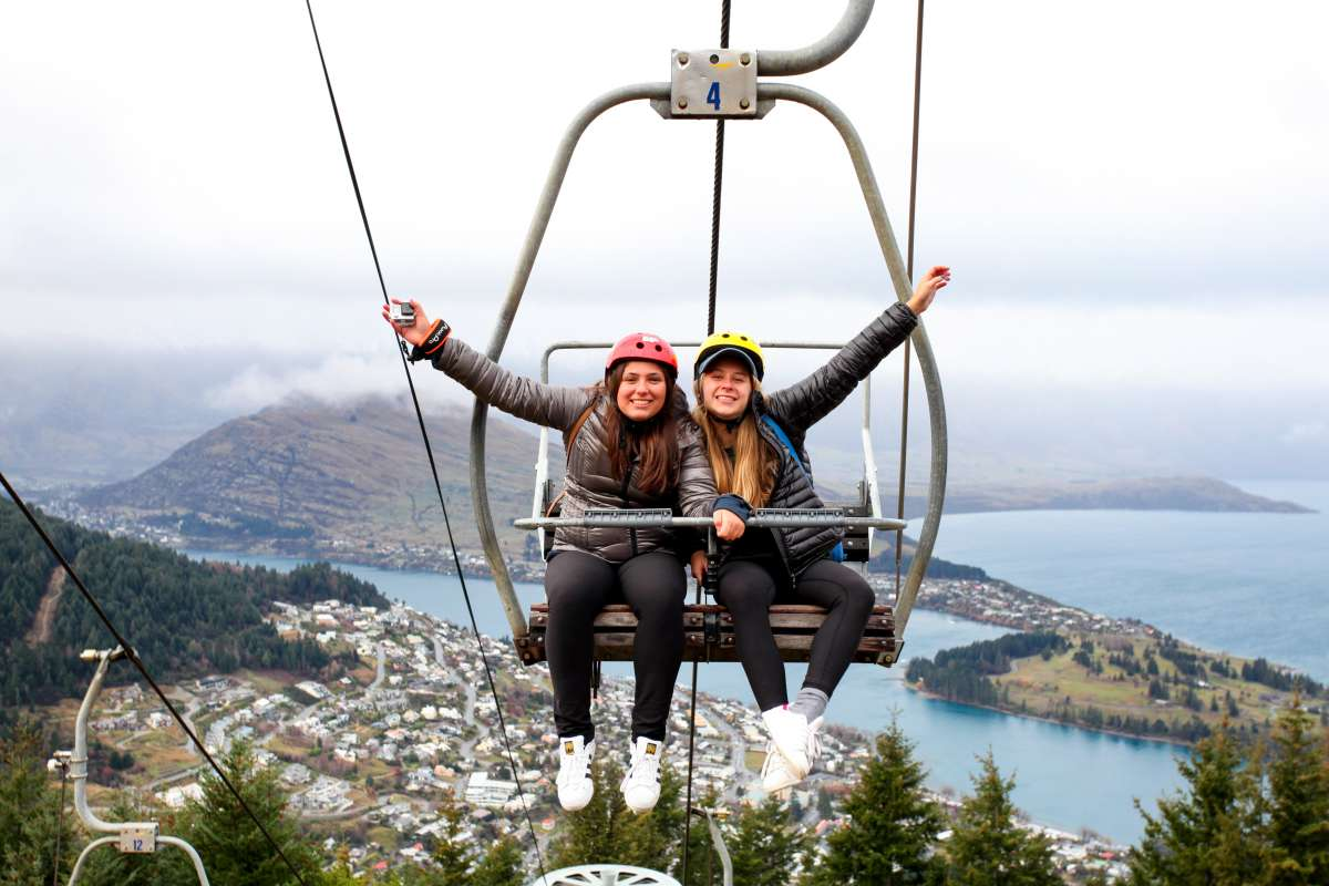 High school students pose on the gondola Queenstown, New Zealand on their summer teen tour.