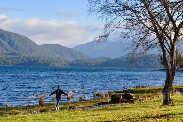 Happy teen traveler explores nature during summer youth travel program in New Zealand