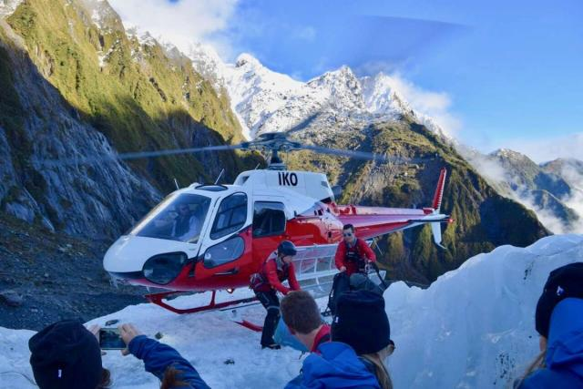 Teenage travelers go on helicopter tour during summer youth travel program in New Zealand