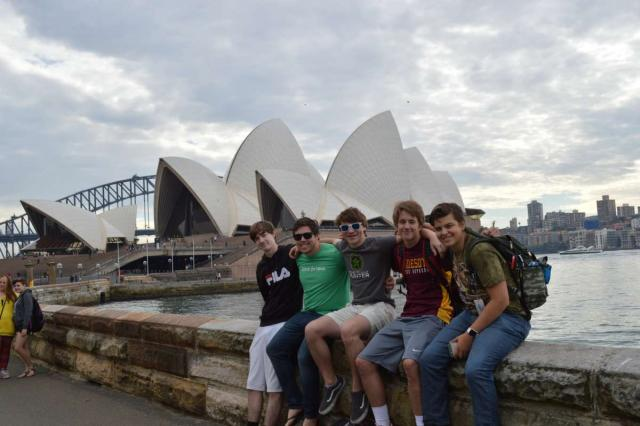 High school student traveler in front of the Sydney Opera House on their teen tour Down Under.