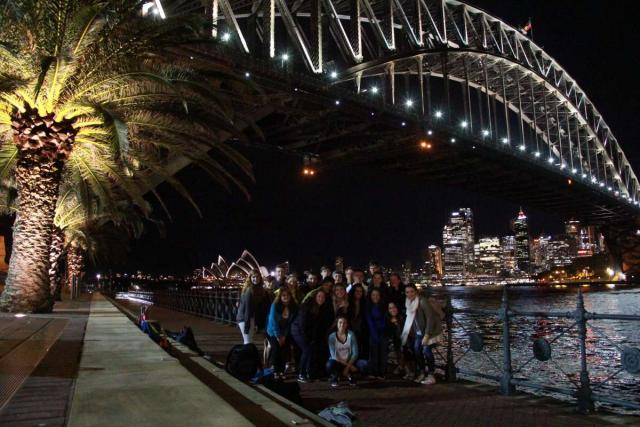Students pose for a photo under the Sydney Harbour Bridge on their teen tour of Hawaii and Australia.