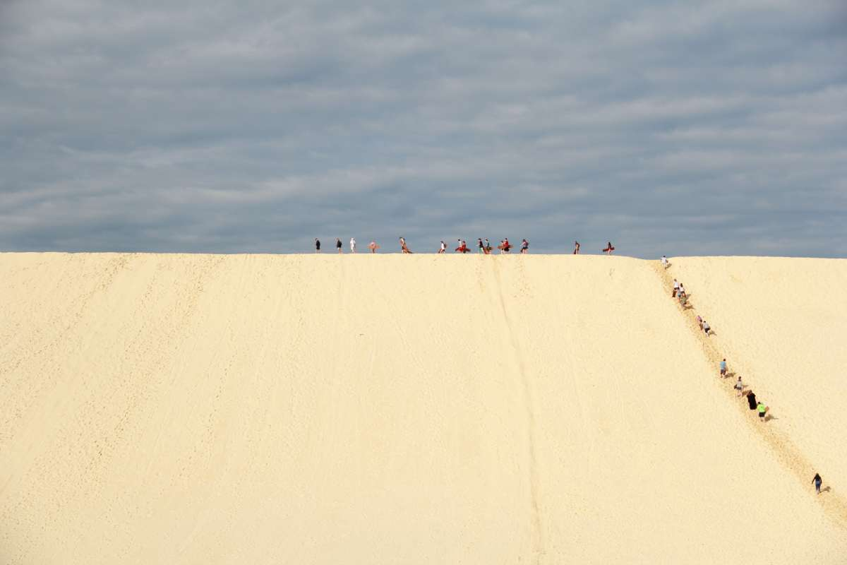 Students adventure around sand dunes on a summer teen to Australia and New Zealand.