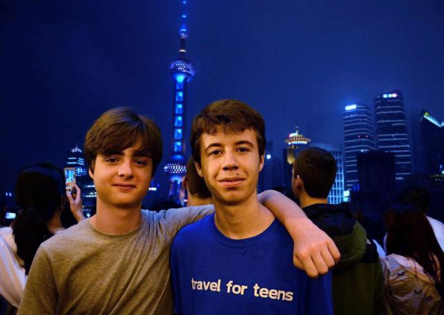 Students pose with the city behind them on their teen tour of China.