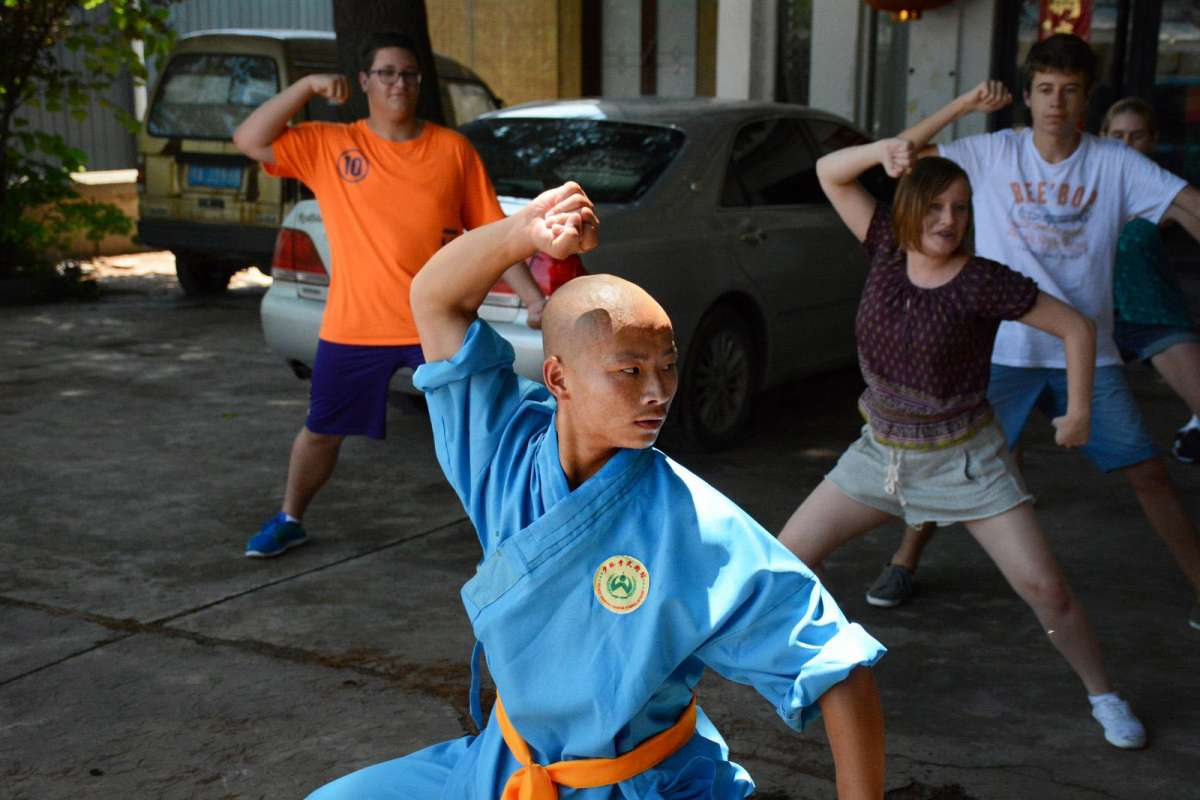 Teens practice martial arts on their student travel tour of China.