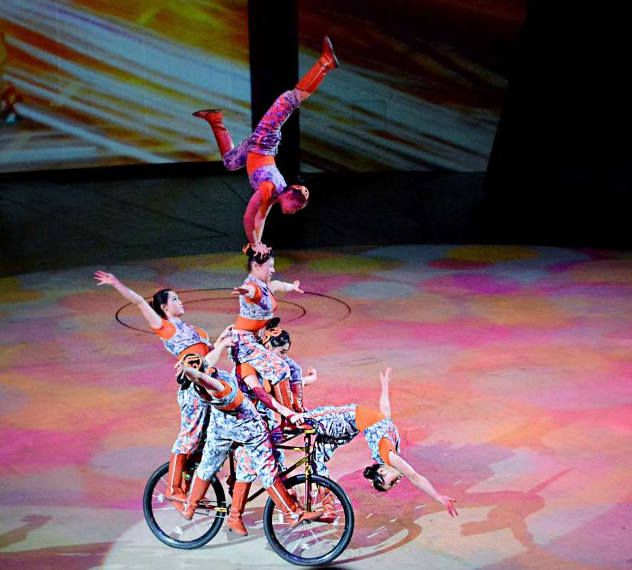 Teens watch an acrobatic performance during their summer tour of China.