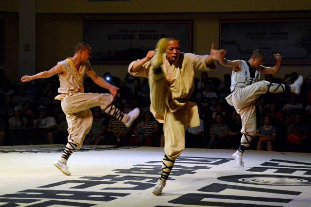 Teens watch a traditional martial arts performance on their student tour of China.