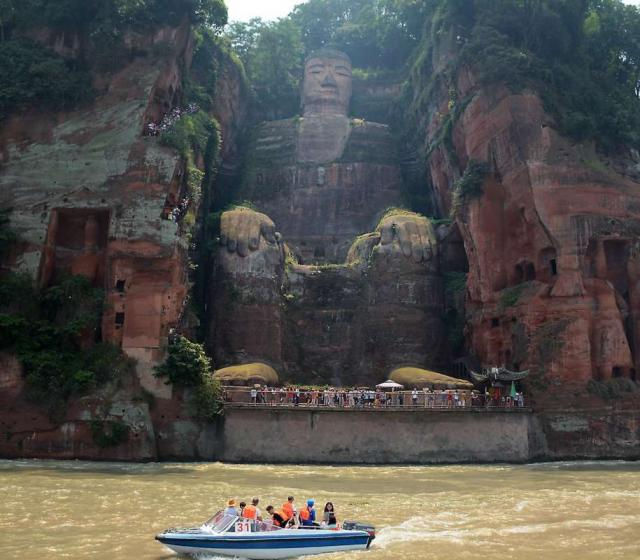 Teens enjoy a boat ride on their summer tour of China.