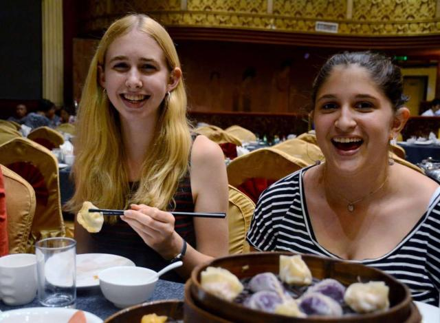 Teens enjoy traditional Chinese food on their summer teen tour of China.