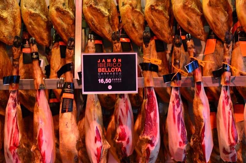 Spanish ham jamon serrano de bellota seen in marketplace during summer teen travel program in Spain