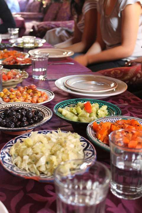 Traditional authentic Moroccan cuisine enjoyed by teen travelers during summer youth adventure program