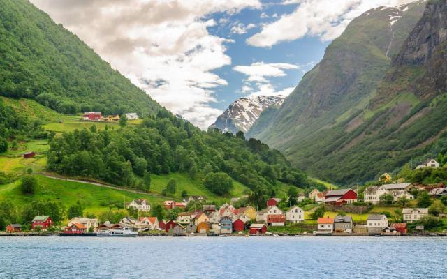 View of Norwegian village nestled between fjords seen by student travelers during summer youth travel program in Scandinavia