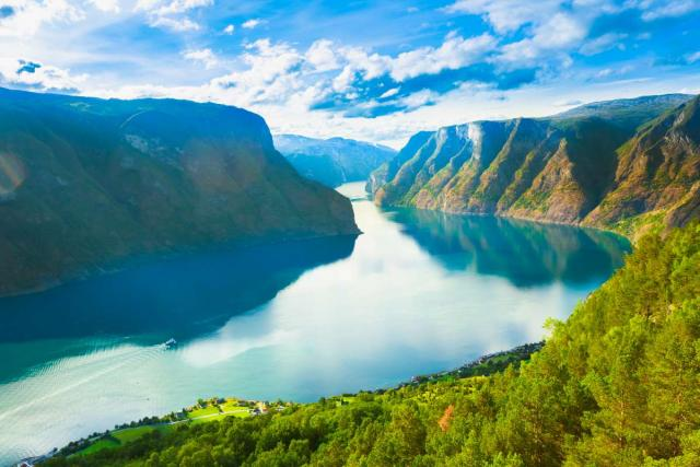 Beautiful landscape view of Norwegian fjords seen by teenage travelers during summer youth travel program in Scandinavia
