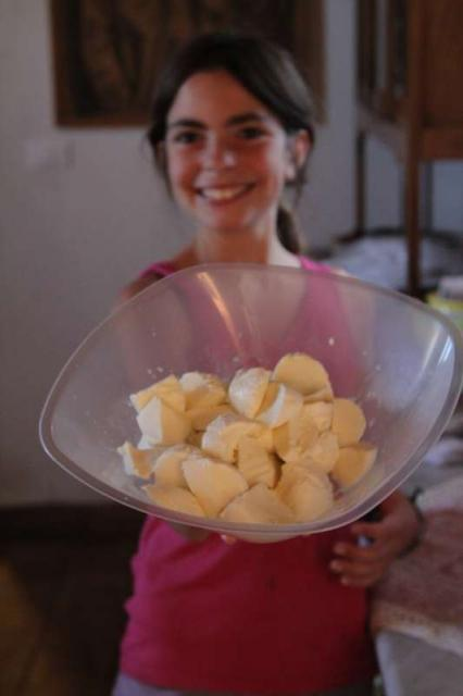 Teenage traveler makes homemade butter in Sicily during summer youth travel program in Italy