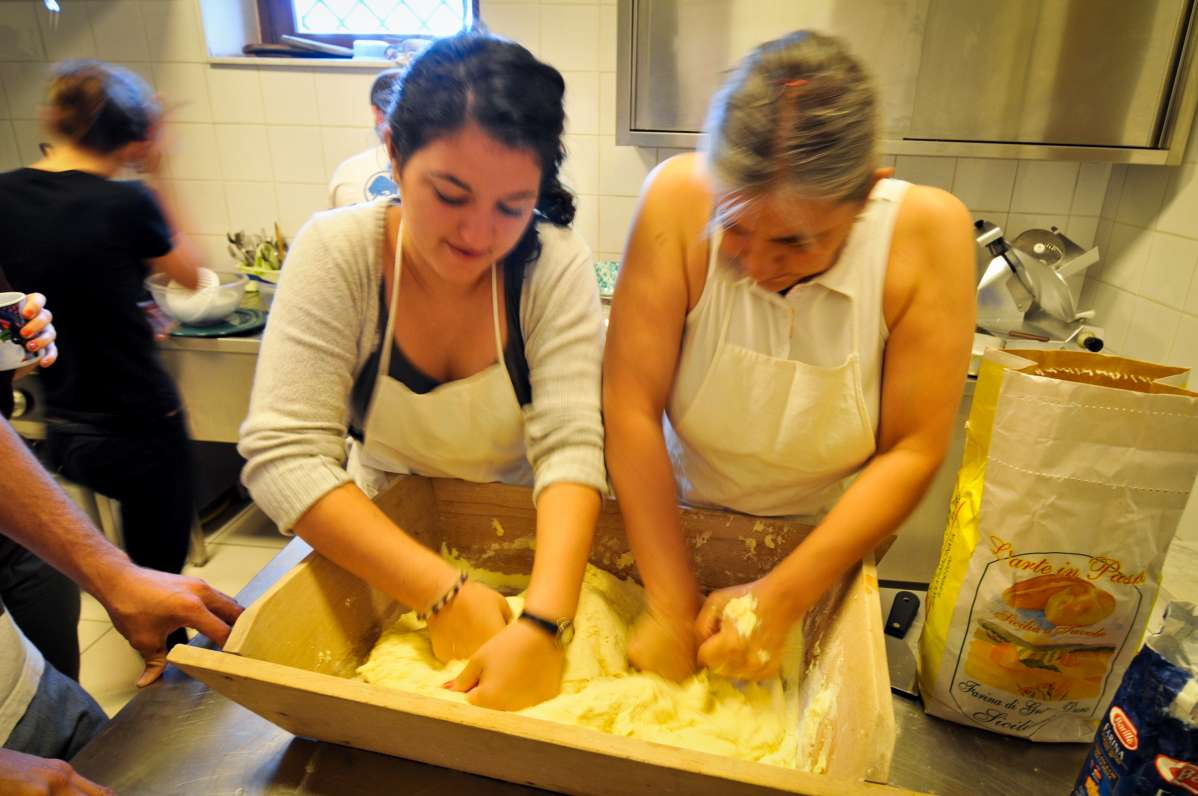 Teenage travelers learn how to make authentic Italian food in Sicily during summer youth travel program in Italy