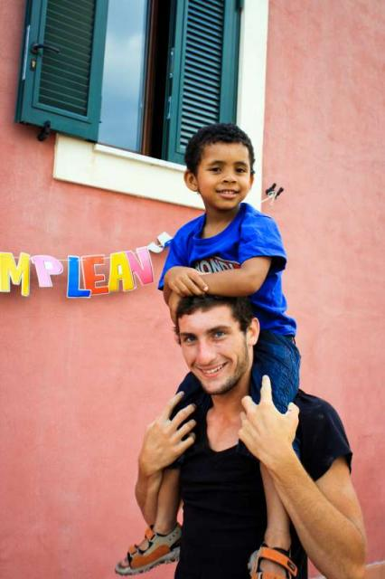 Teenage boy traveler with little Italian boy during summer youth travel program in Sicily Italy