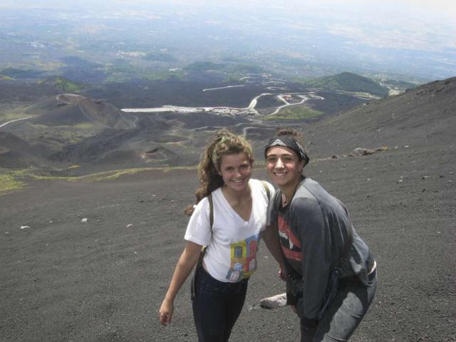 teenage travelers climb Mount Etna during summer youth travel program in Sicily Italy