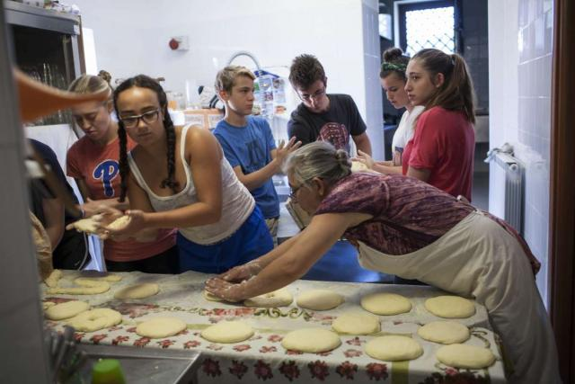 Teenage travelers learn how to make local Italian food during summer youth travel program in Italy