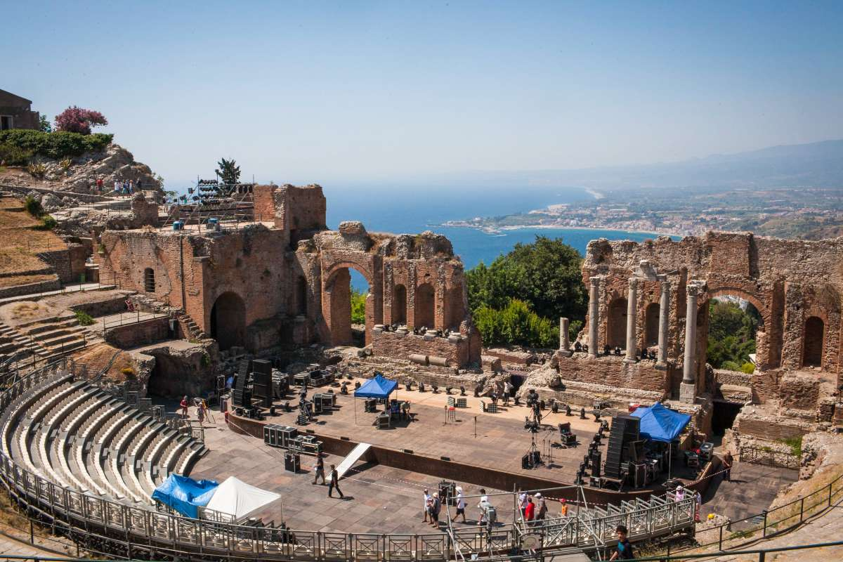 Ancient Roman amphitheater archaeological ruins in Sicily seen by teen travelers during summer youth travel program in Italy