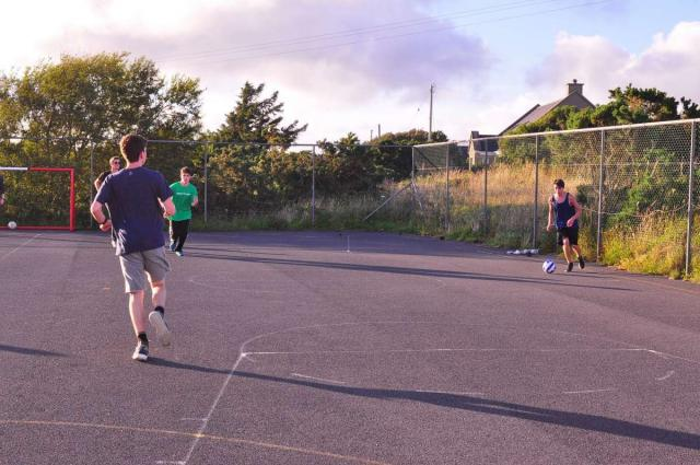 Teenage travelers playing soccer in Ireland during summer youth adventure travel program