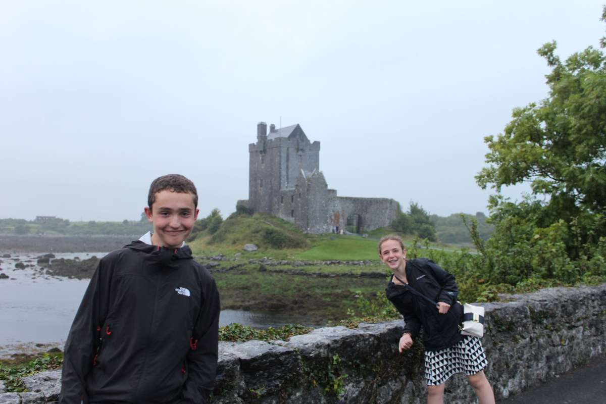 Teenage travelers explore Irish castle on summer youth adventure travel program
