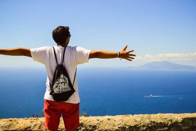 High school teen enjoys the Italian views on their summer tour to Italy.