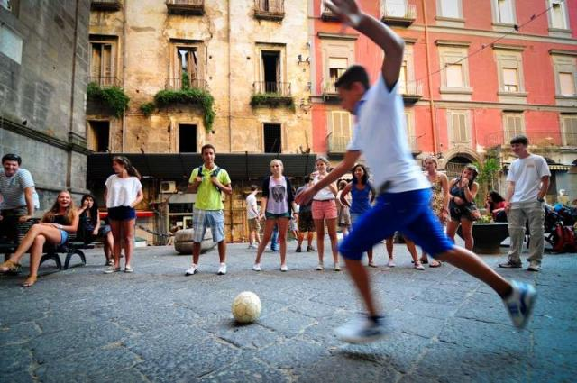 High school teens play soccer in Italy during their summer program.