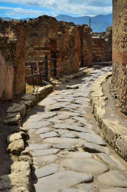 High school students wander the streets of Pompeii on their summer teen tour to Italy.