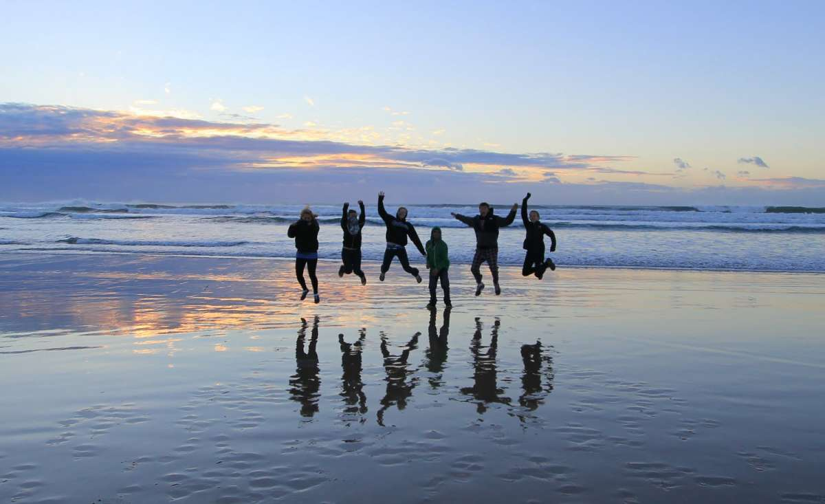 Students jump for joy on their summer service and safari tour for teens in South Africa.