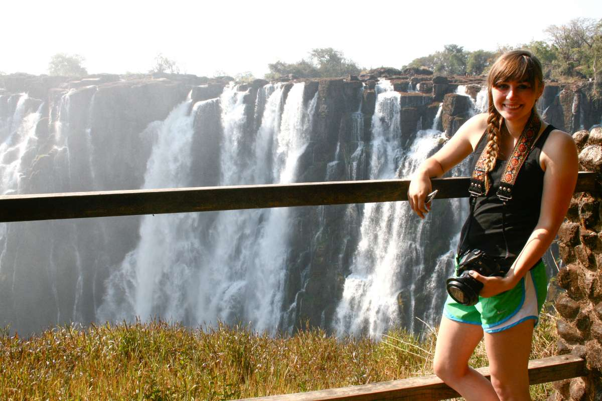 Teen enjoys the view of a waterfall in South Africa on summer service and safari program.