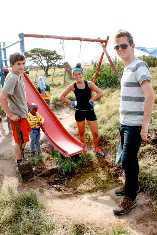 Teens improve a playground as part of service and safari program in South Africa.
