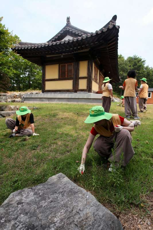 Teenage volunteers performing community service at Golgulsa Temple in Korea during summer service program