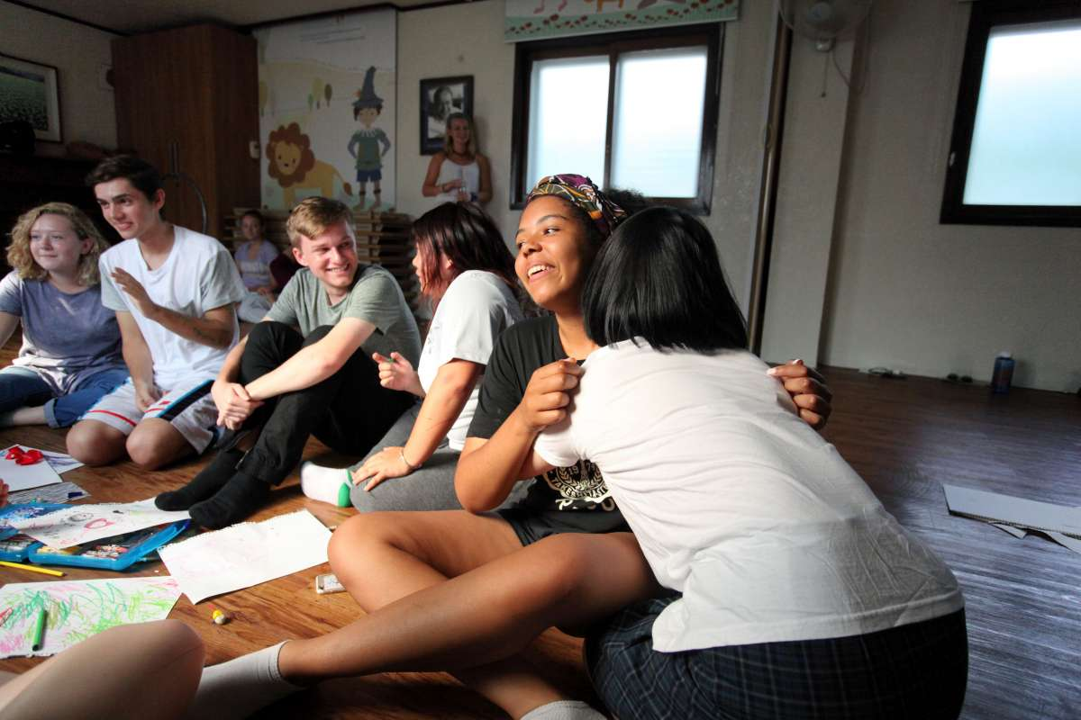 Teenage travelers volunteer and interact with locals at orphanage in Suncheon during summer service program