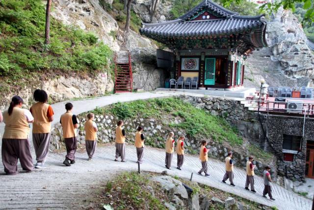 Teenage travelers do morning walking meditation at Golgulsa Temple during overnight stay while on summer teen travel program