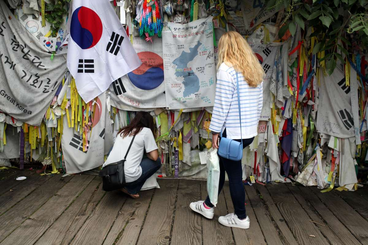 Teenage travelers visit Korean DMZ area between North Korea and South Korea on summer youth travel program