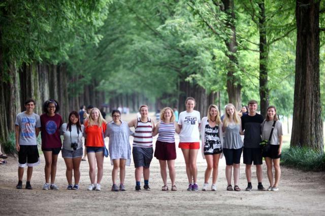 Teenage travelers visit Damyang metasequoia trees during summer youth travel program in Korea