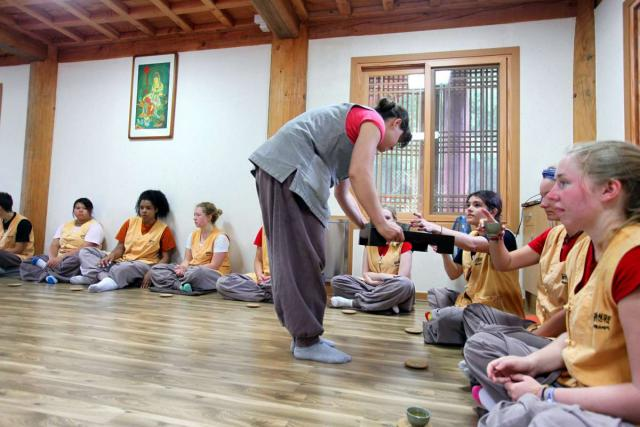 Teenage travelers participate in tea ceremony at Golgulsa Temple during summer youth travel program