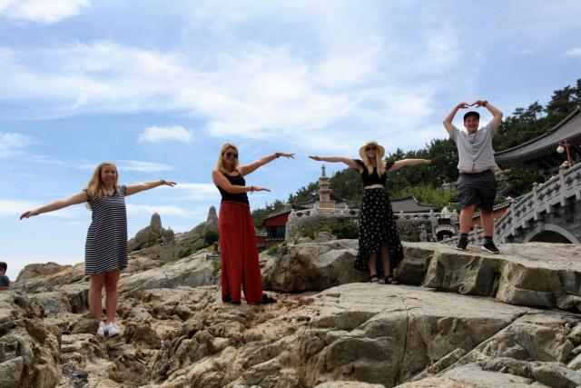 Teenage travelers visit Haedong Yonggungsa temple during summer youth travel program in Busan