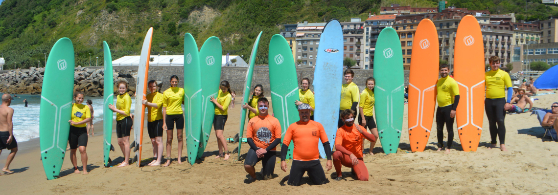Teenage travelers surfing in San Sebastian during summer Spanish language immersion program