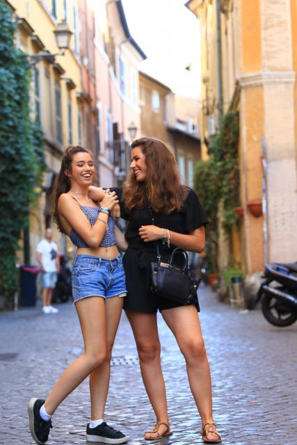 Teenage travelers laughing in Florence on summer teen photography program