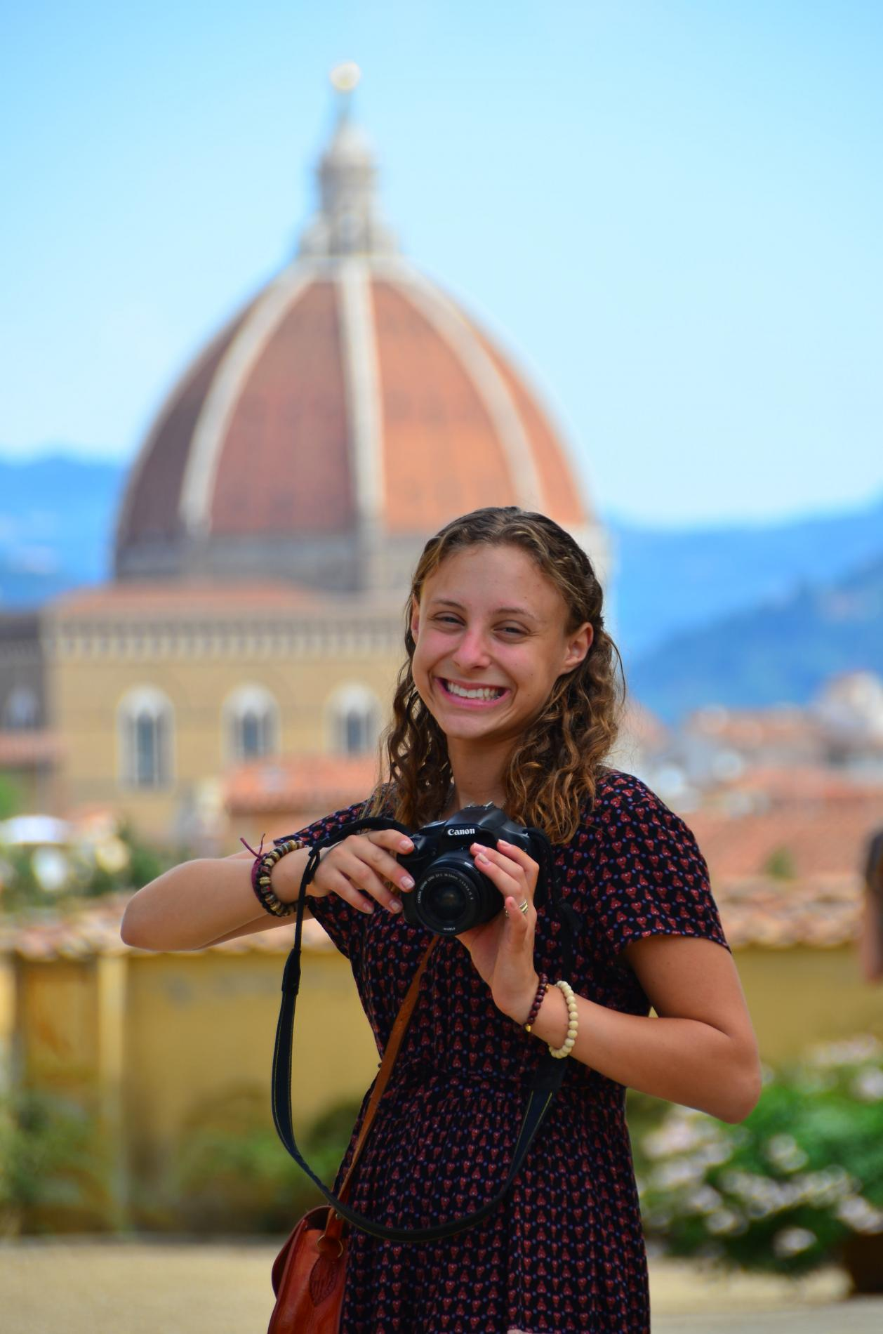 Teenage traveler photographing Florence Duomo on summer travel photography program