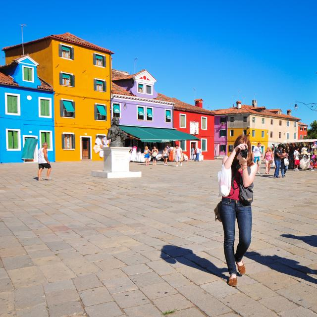 Teenage travel photographer on Murano island in Venice on summer photography program